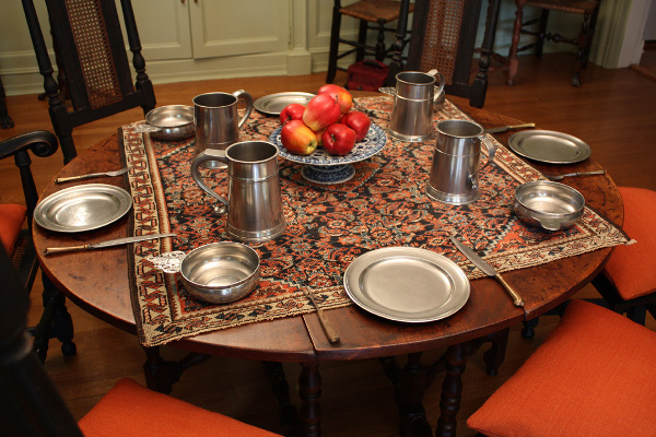 This period table setting shows a superb selection of American mugs plates and porringers. We will help you develop an outstanding grouping like this. & Displaying Your Pewter