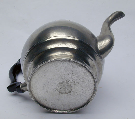A Pewter Inverted Mold Pewter Teapot by J.B. Woodbury