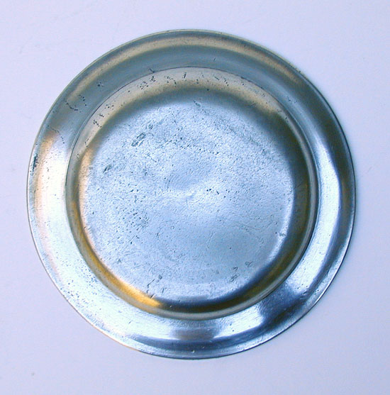 An Unmarked American Pewter Butter Plate