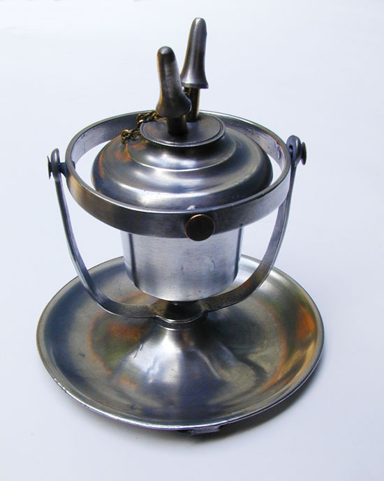 An Antique Pewter True Gimbal Lamp