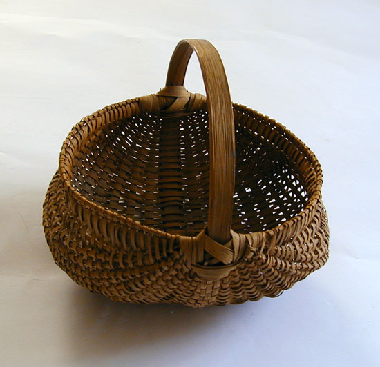 A Late 19th early 20th Century Buttocks Basket