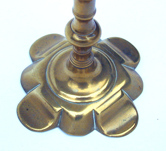 A Queen Anne Petal Base Brass Candlestick