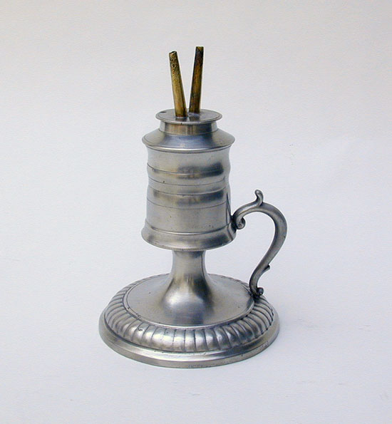 An Unmarked Pewter Fluid Lamp With Gadrooned Decoration