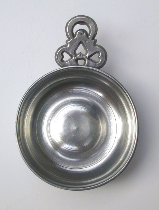 A Pewter Porringer with Heart and Crescent Moon Handle